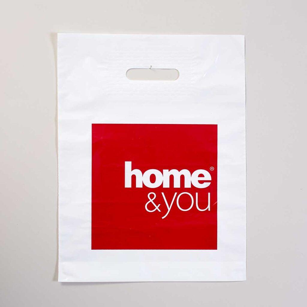 """Полиэтиленовый пакет с изображением логотипа """"home&you""""."""